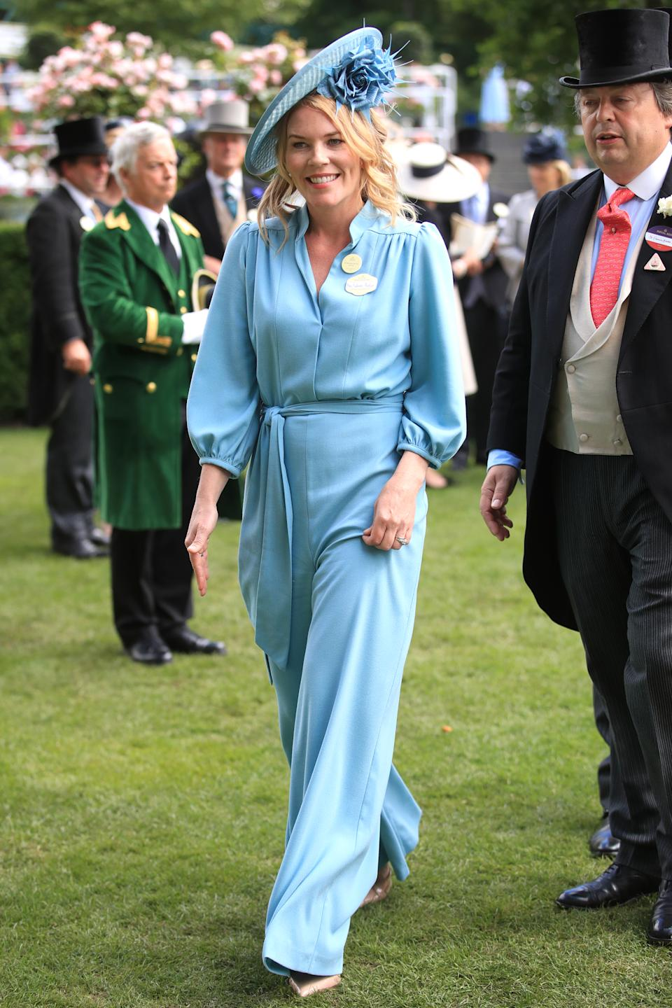 """Autumn Phillips looked chic in a bespoke powder blue jumpsuit by Claire Mischevani (available in white <a href=""""https://fave.co/2Kz7vhh"""" rel=""""nofollow noopener"""" target=""""_blank"""" data-ylk=""""slk:here"""" class=""""link rapid-noclick-resp"""">here</a>) with a hat by Sally Ann Provan. <em>[Photo: Getty]</em>"""
