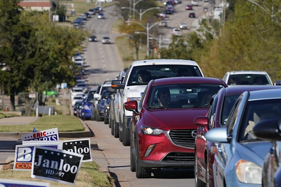 Cars line the street outside the election board in Oklahoma City on Thursday. The US elections have been complicated by the coronavirus pandemic, which has helped spur the use of early voting. Photo: AP