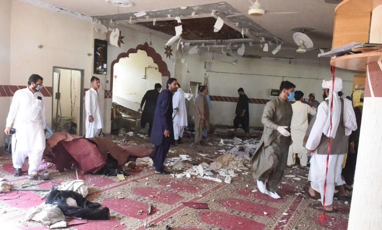 Security officials examined the site of a blast at a mosque in the town of Kuchlak that killed the Afghan Taliban leader's brother in southwest Quetta on August 16, 2019 (AFP Photo/BANARAS KHAN)
