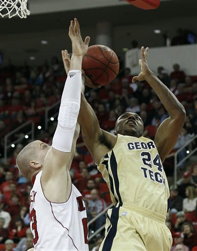 North Carolina State's Thomas de Thaey, left, guards Georgia Tech's Kammeon Holsey (24) during the first half of an NCAA college basketball game in Raleigh, N.C., Wednesday, Jan. 11, 2012. (AP Photo/Gerry Broome)