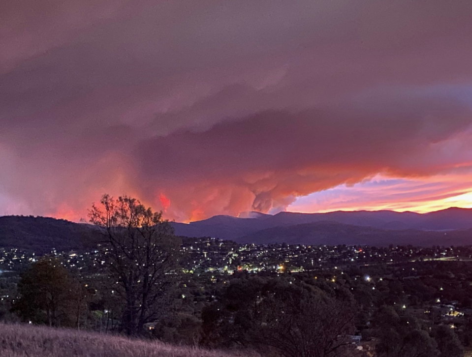 Pictured are plumes of smoke against a purple sky in Canberra.