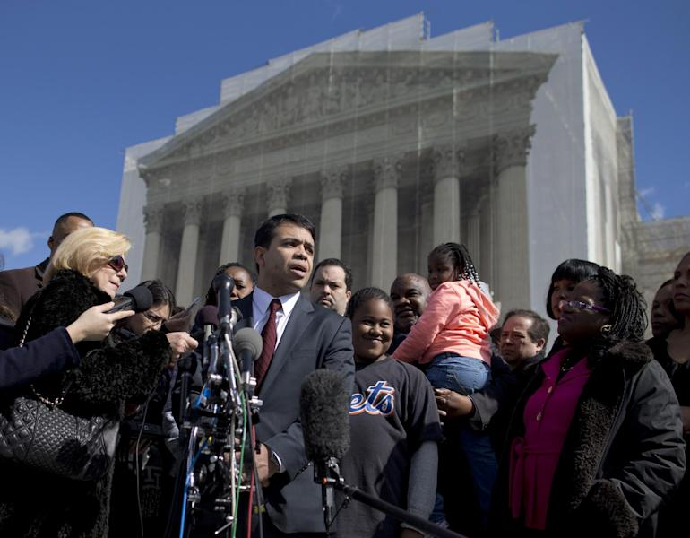 FILE - In this Feb. 27, 2013 file photo special counsel of the NAACP Legal Defense Fund, Debo Adegbile, speaks with the media outside the Supreme Court in Washington after presenting arguments in the Shelby County, Ala., v. Holder voting rights case. At the time Adegbile was the first, and as it turned out, the only, African-American to make a high court argument this term. The numbers were marginally better for Hispanic lawyers, four of whom argued for a total of 1 hour, 45 minutes. Women were better represented, accounting for just over 17 percent of the arguments before the justices. (AP Photo/Evan Vucci, File)