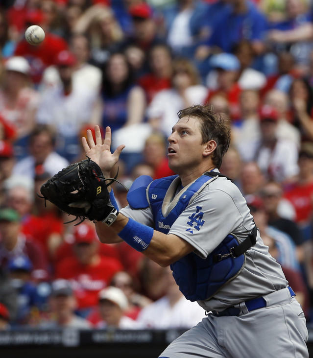 Los Angeles Dodgers catcher A.J. Ellis catches a pop out by Philadelphia Phillies' Jimmy Rollins during the first inning of a baseball game, Saturday, May 24, 2014, in Philadelphia. (AP Photo/Matt Slocum)