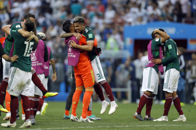 Mexico's Carlos Salcedo, center right, and goalkeeper Alfredo Talavera celebrate at the end of the group F match between Germany and Mexico at the 2018 soccer World Cup in the Luzhniki Stadium in Moscow, Russia, Sunday, June 17, 2018. (AP Photo/Victor R. Caivano)