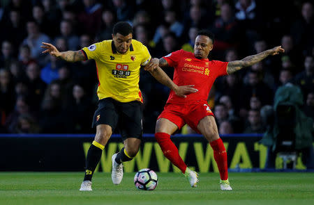 Britain Football Soccer - Watford v Liverpool - Premier League - Vicarage Road - 1/5/17 Liverpool's Nathaniel Clyne in action with Watford's Troy Deeney Action Images via Reuters / Andrew Couldridge Livepic