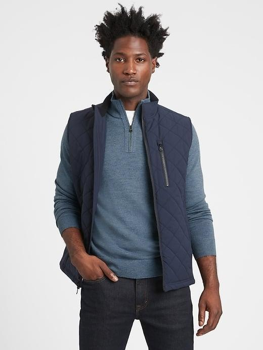 <p>While a <span>Banana Republic Merino Half-Zip Sweater</span> ($90) looks stylish on its own, it looks even better layered under the <span>Banana Republic Motion Tech Quilted Vest</span> ($169).</p>