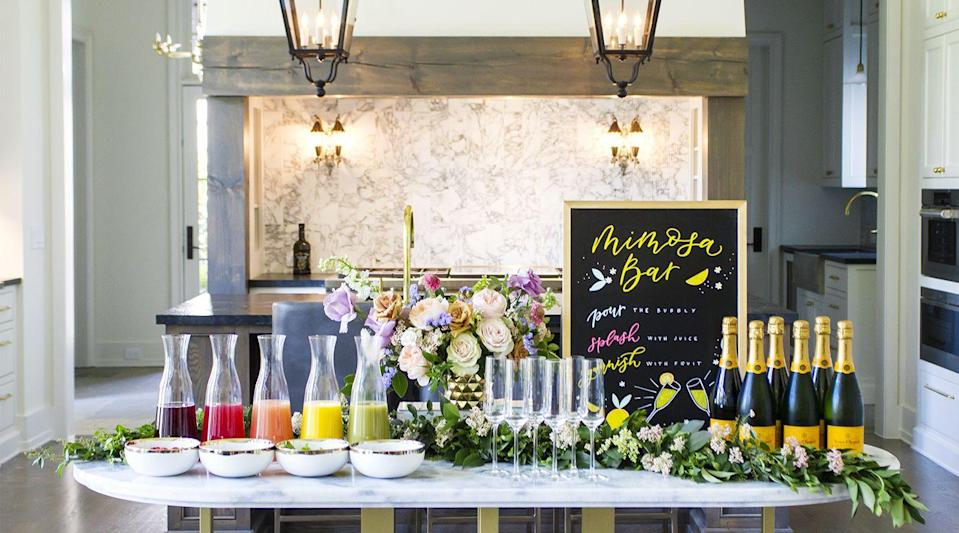 "<p>Use a chalkboard, poster paper, or canvas to craft a pretty mimosa bar directions board. Here's what to put on it: 1) Pour the bubbly, 2) Splash with juice, and 3) Garnish with fruit. Easy!</p><p>See more at <a href=""https://carriecolbert.com/how-to-create-an-easy-at-home-diy-mimosa-bar/"" rel=""nofollow noopener"" target=""_blank"" data-ylk=""slk:Carrie Colbert"" class=""link rapid-noclick-resp"">Carrie Colbert</a>.</p>"