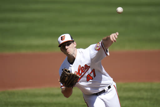 Baltimore Orioles starting pitcher John Means throws a pitch to the Tampa Bay Rays during the first inning of a baseball game, Sunday, Sept. 20, 2020, in Baltimore. (AP Photo/Julio Cortez)