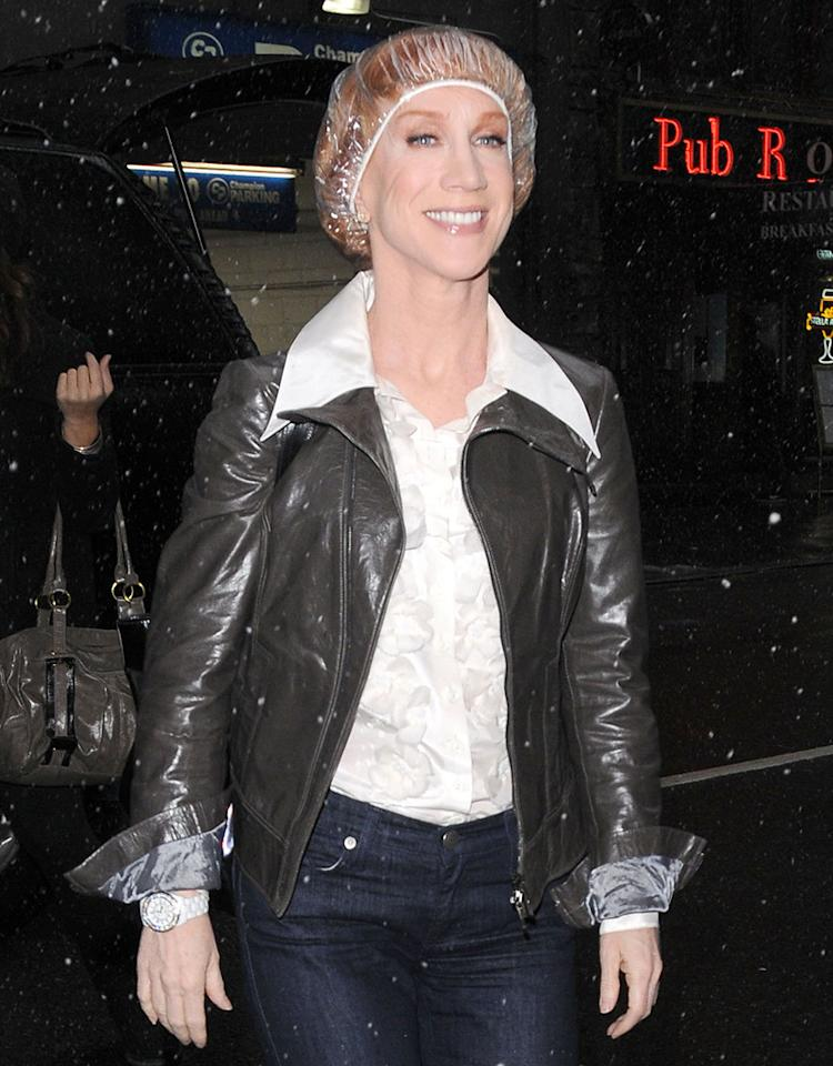 Kathy Griffin wears a shower cap on a snowy day as she arrives at her hotel in New York City.