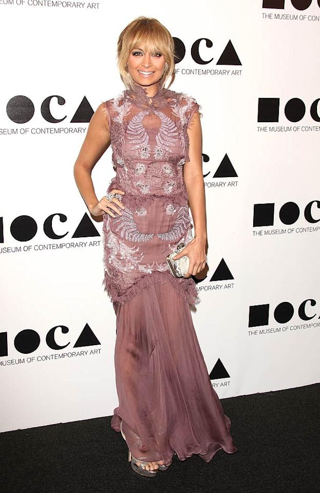 Following in Stefani's footsteps at the MOCA soiree was fellow fashion designer Nicole Richie, who made the mistake of donning this Julien Macdonald mess that happened to be both messy and matronly at the same time. (11/12/2011)