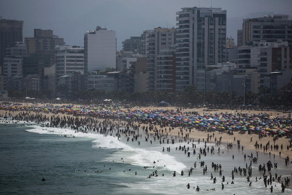 People enjoy the Ipanema beach amid the new coronavirus pandemic in Rio de Janeiro, Brazil, Sunday, Sept.6, 2020. Brazilians are packing the beaches and bars this weekend, taking advantage of a long holiday to indulge in normal life even as the COVID-19 pandemic rages on. (AP Photo/Bruna Prado)