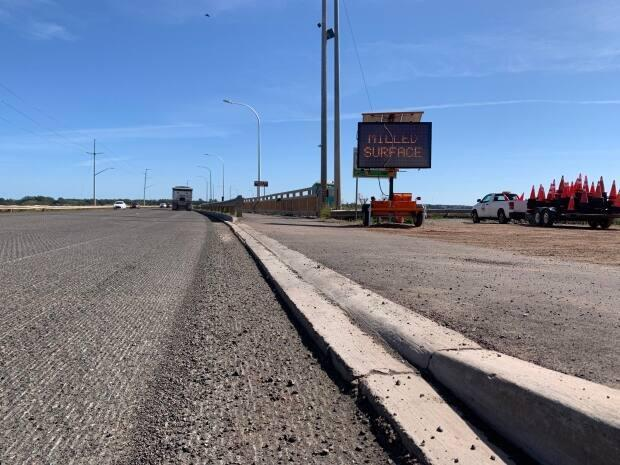 The old asphalt at the approaches to the Hillsborough Bridge was milled in two days. The Department of Transportation says it would likely have taken twice that time if it were done during the day. (Shane Ross/CBC - image credit)