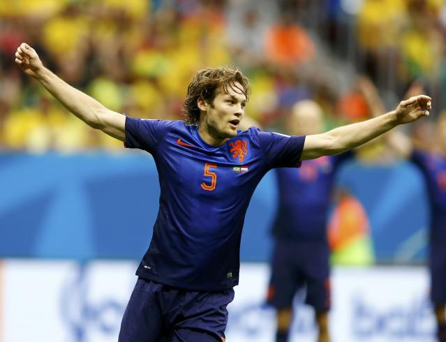 Daley Blind of the Netherlands celebrates scoring their second goal during their 2014 World Cup third-place playoff against Brazil at the Brasilia national stadium in Brasilia July 12, 2014. REUTERS/Dominic Ebenbichler (BRAZIL - Tags: SOCCER SPORT WORLD CUP TPX IMAGES OF THE DAY)