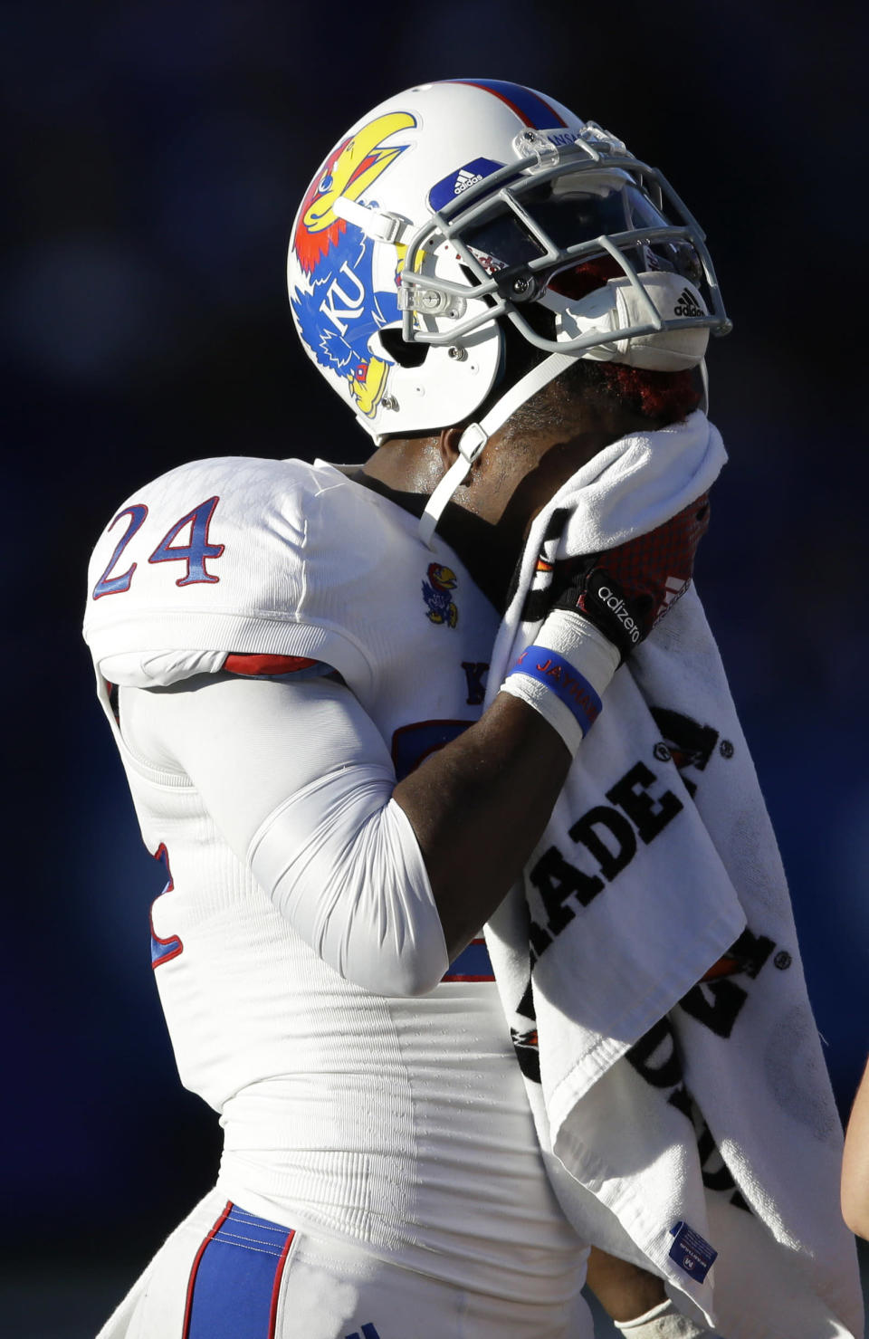 Kansas cornerback JaCorey Shepherd towels off during the first half of an NCAA college football game against Kansas State in Manhattan, Kan., Saturday, Nov. 29, 2014. (AP Photo/Orlin Wagner)