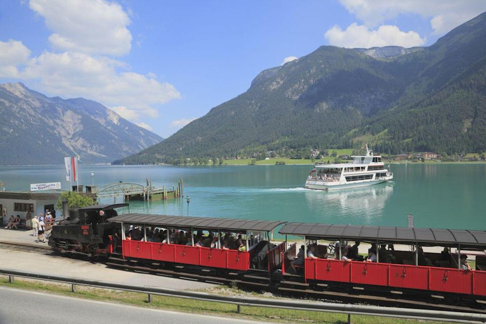 "<p>One of the best ways to see Austria's dramatic valleys and glittering lakes is with a ride on the charming Achensee Cog Railway. </p><p>Running since the late 1800s, it's Europe's oldest coal-fired steam engine and carries passengers from Jenbach, past wildflower meadows and dense forest, up to the shores of Lake Achensee.</p><p>The seven-kilometre ride takes you 450 metres from the valley floor through woods and fields to the lakeside - it's as lovely as they come.<strong><br></strong></p><p><strong>You can experience this unique train during an Austrian mountain holiday with Inghams.</strong> </p><p><a class=""link rapid-noclick-resp"" href=""https://go.redirectingat.com?id=127X1599956&url=https%3A%2F%2Fwww.inghams.co.uk%2Fdestinations%2Faustria%2Flake-achensee%2Fpertisau&sref=https%3A%2F%2Fwww.goodhousekeeping.com%2Fuk%2Flifestyle%2Ftravel%2Fg27645232%2Frail-holidays%2F"" rel=""nofollow noopener"" target=""_blank"" data-ylk=""slk:FIND OUT MORE"">FIND OUT MORE</a></p>"