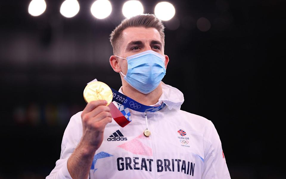 Max Whitlock stands atop the podium - GETTY IMAGES