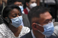 Journalists wearing a protective face mask to help curb the spread of the new coronavirus attend a press conference for the white paper on fighting COVID-19 China in action which is chaired by Xu Lin, vice head of the publicity department of the communist party, at the State Council Information Office in Beijing, Sunday, June 7, 2020. Senior Chinese health officials defended their country's response to the new coronavirus pandemic, saying they provided information in a timely and transparent manner. (AP Photo/Andy Wong)