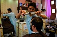 After the Taliban's first stint in power ended, being clean-shaven was often considered a sign of modernity (AFP/Hoshang Hashimi)