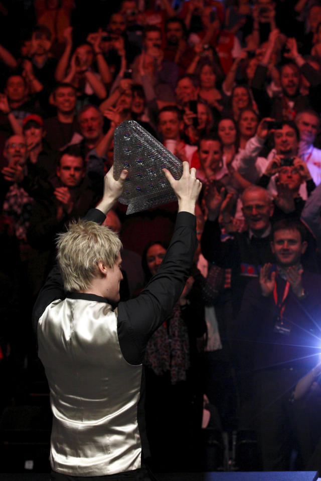 Australia's Neil Roberts raises the Masters trophy after winning over England's Shaun Murphy in the BGC Masters snooker final at Alexandra Palace in London on January 22, 2012. Australia's 2010 world champion Neil Robertson claimed the Masters title with a 10-6 win over England's Shaun Murphy at Alexandra Palace. AFP PHOTO / JUSTIN TALLIS (Photo credit should read JUSTIN TALLIS/AFP/Getty Images)