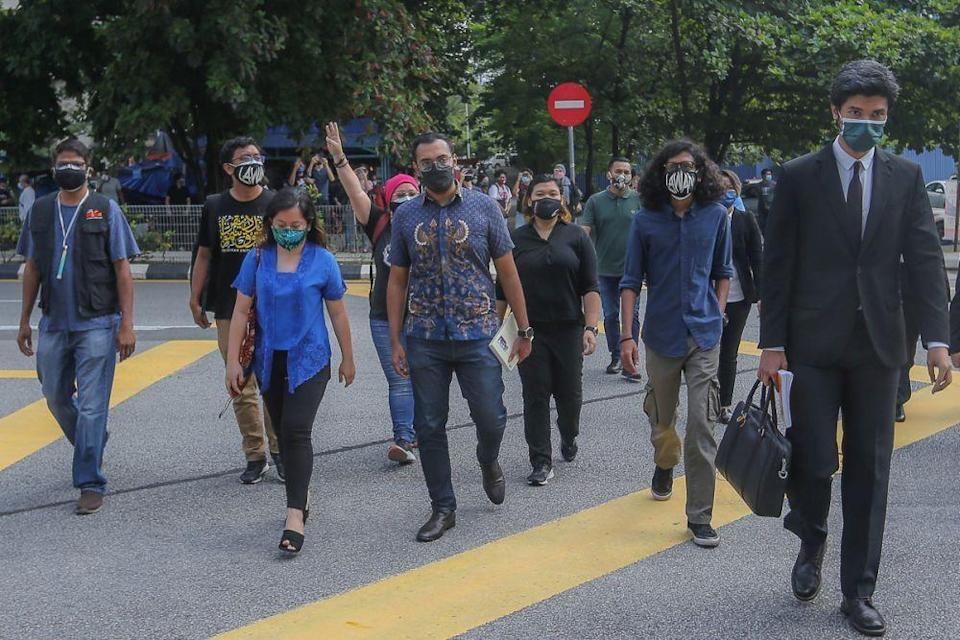 #Lawan rally participants arrive to give their statements at the Dang Wangi district police headquarters in Kuala Lumpur August 2, 2021. — Picture by Yusof Mat Isa