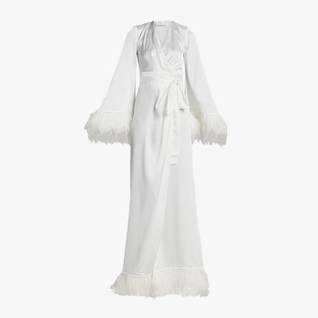"""$995, REVOLVE. <a href=""""https://www.revolve.com/bronx-and-banco-feather-long-robe/dp/BROR-WD218/"""" rel=""""nofollow noopener"""" target=""""_blank"""" data-ylk=""""slk:Get it now!"""" class=""""link rapid-noclick-resp"""">Get it now!</a>"""