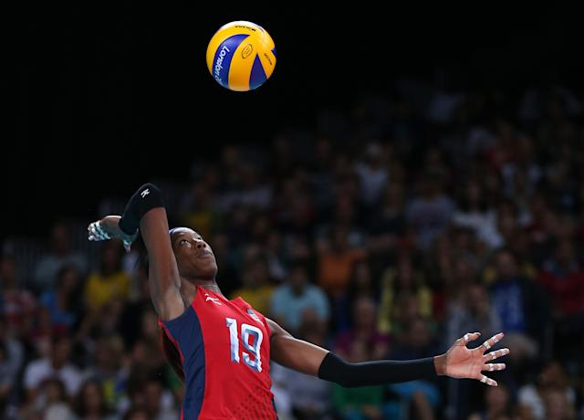 LONDON, ENGLAND - JULY 30: Destinee Hooker of United States serves in the Women's Volleyball Preliminary match between the United States and Brazil on Day 3 of the London 2012 Olympic Games at Earls Court on July 30, 2012 in London, England. (Photo by Elsa/Getty Images)