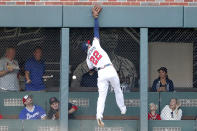 A triple by St. Louis Cardinals' Tommy Edman gets past Atlanta Braves' Nick Markakis during the second inning of Game 5 of their National League Division Series baseball game, Wednesday, Oct. 9, 2019, in Atlanta. (AP Photo/John Bazemore)
