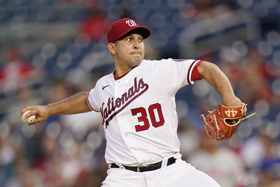 Washington Nationals starting pitcher Paolo Espino throws to the Philadelphia Phillies in the fourth inning of a baseball game, Wednesday, Aug. 4, 2021, in Washington. (AP Photo/Patrick Semansky)