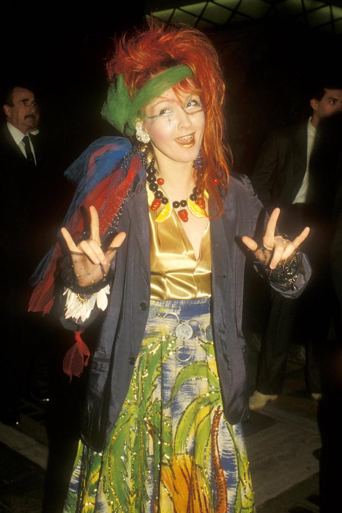 """<h3>Cyndi Lauper, 1984</h3><br>Fresh off the release of her smash hit """"Girls Just Want To Have Fun"""" the year before, Cyndi Lauper wore colorful tulle fabric tied around her vibrant red dye job. <span class=""""copyright"""">Photo: Barry King/WireImage.</span>"""