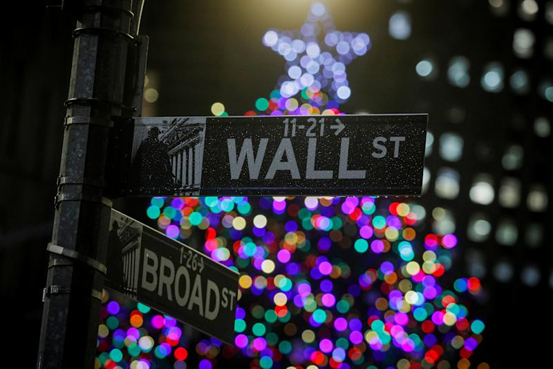 A Christmas tree is seen on Wall St. outside the New York Stock Exchange (NYSE) in New York, U.S., December 17, 2019. REUTERS/Brendan McDermid
