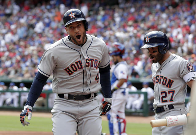 Houston Astros' George Springer (4) celebrates his solo home run with Jose Altuve (27) in the first inning of a baseball game against the Texas Rangers in Arlington, Texas, Thursday, March 29, 2018. (AP Photo/Tony Gutierrez)