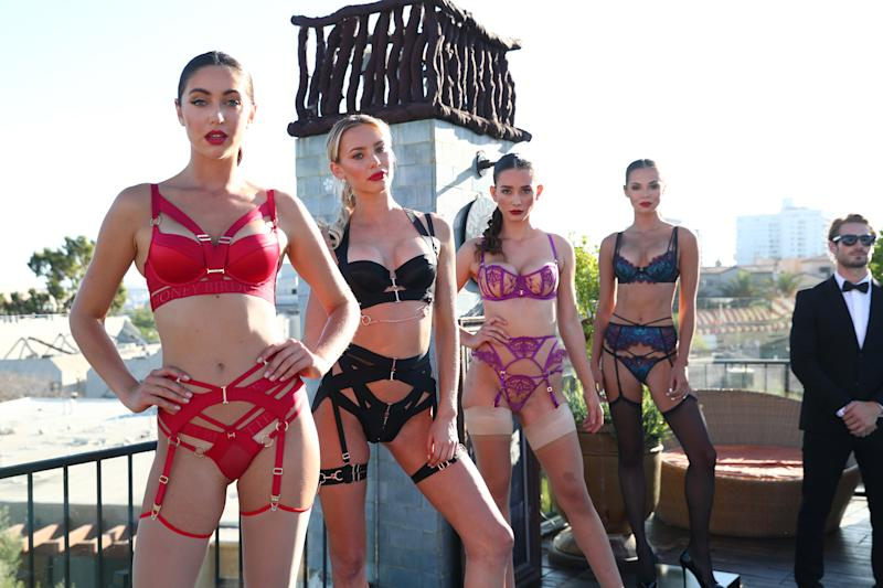 Four Honey Birdette lingerie models pose at pool party