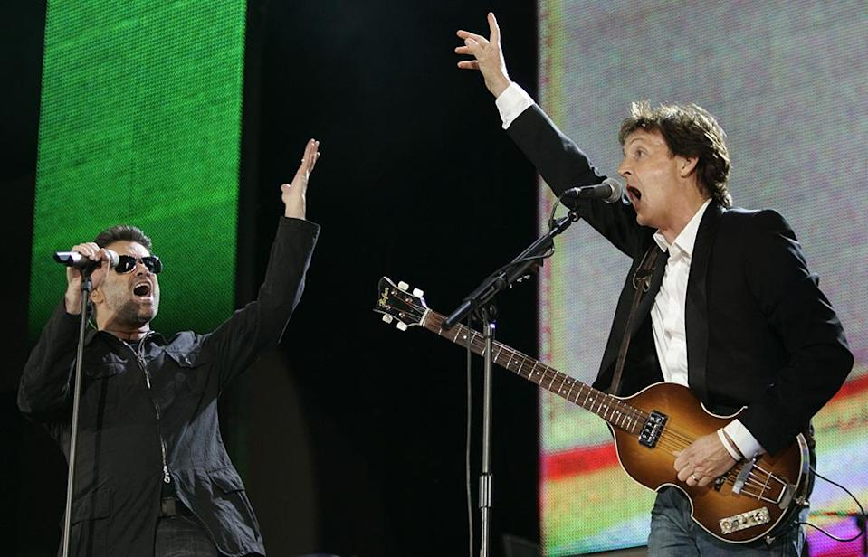 <p>In this July 2, 2005, photo, George Michael and Paul McCartney perform during the <i>Live 8</i>concert in Hyde Park, London. (Photo: AP/Lefteris Pitarakis) </p>