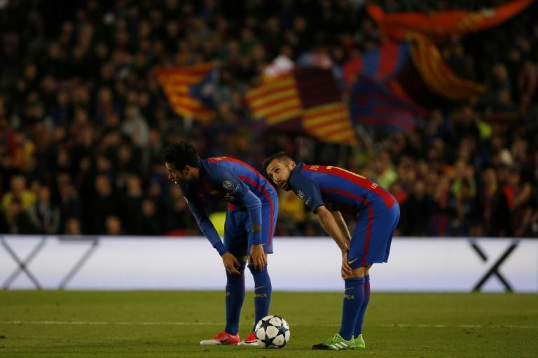 Barcelona's Neymar (L) and teammate Jordi Alba bend over after their UEFA Champions League quarter-final second leg match against Juventus at the Camp Nou stadium in Barcelona on April 19, 2017