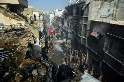 The PIA plane was close to landing when it came down among houses
