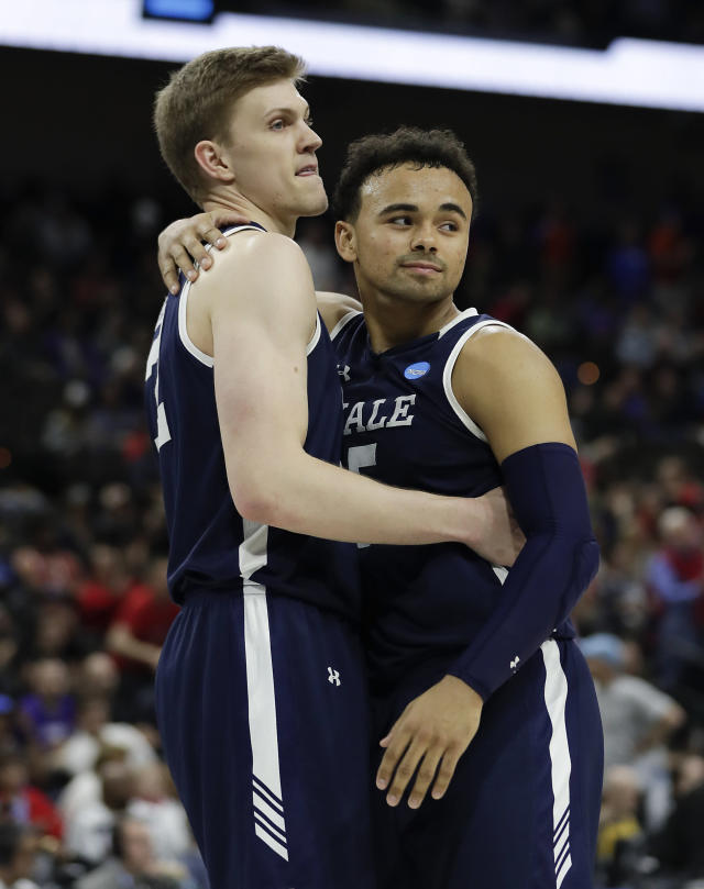 <p>Yale's Blake Reynolds, left, and Azar Swain console each other after losing 79-74 to LSU in a first round men's college basketball game in the NCAA Tournament, in Jacksonville, Fla. Thursday, March 21, 2019. (John Raoux/AP) </p>