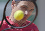 Switzerland's Roger Federer plays a return to Uzbekistan's Denis Istomin during their first round match on day two of the French Open tennis tournament at Roland Garros in Paris, France, Monday, May 31, 2021. (AP Photo/Thibault Camus)