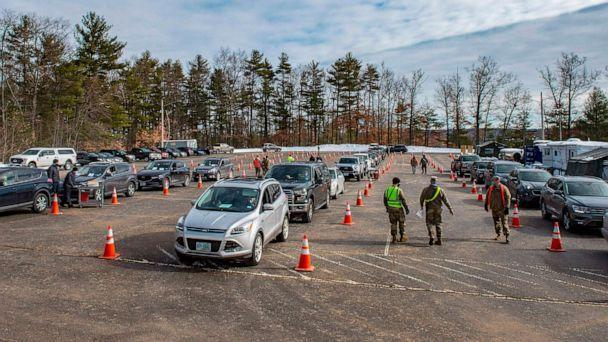 PHOTO: Cars line up at a vaccination center in Londonderry, N.H., Feb. 4, 2021. (Joseph Prezioso/AFP via Getty Images, FILE)