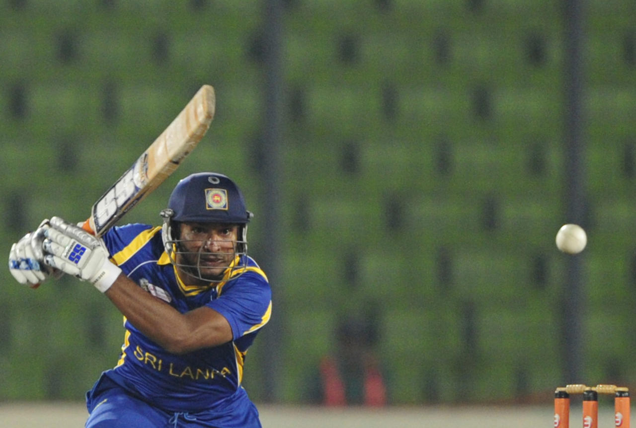 Sri Lankan cricketer Kumar Sangakkara plays a shot during the one day international (ODI) Asia Cup cricket match between India and Sri Lanka at The Sher-e-Bangla National Cricket Stadium in Dhaka on March 13, 2012. AFP PHOTO/Munir uz ZAMAN (Photo credit should read MUNIR UZ ZAMAN/AFP/Getty Images)