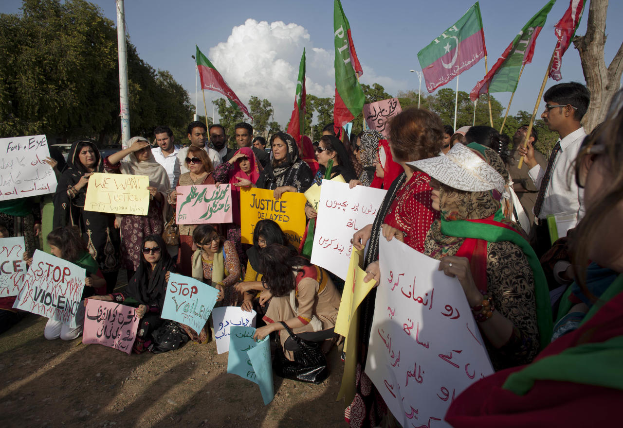 "Women supporters of Pakistan's political party Tehreek-e-Insaf headed by former cricket star Imran Khan, pray for acid attack victim Fakhra Younnus, Monday, March 26, 2012 in Islamabad, Pakistan. Fakhra who committed suicide by jumping from the sixth floor of her flat in Rome, was a victim of an acid attack allegedly carried out 12 years ago by her husband, the son of a feudal politician. Placard in center reads ""oppression against women is unacceptable ."" (AP Photo/B.K. Bangash)"