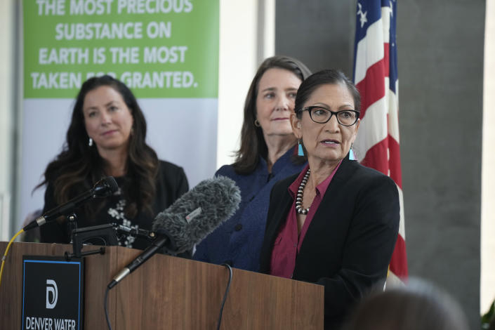 Interior Secretary Deb Haaland responds to a question as Becky Mitchell, left, of the Colorado Water Conservation Board, and U.S. Rep Diana DeGette, D-Colo., look on during a news conference after Haaland's visit to talk about federal solutions to ease the effects of the drought at the offices of Denver Water, Thursday, July 22, 2021, in Denver. Haaland will make stops in two cities on Colorado's Western Slope as part of her trip to assess the effects of the drought on the Centennial State. (AP Photo/David Zalubowski)