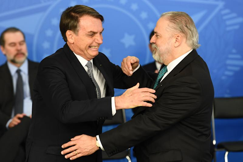 Brazilian President Jair Bolsonaro (L) greets appointed Attorney General Augusto Aras during a ceremony to take office at Planalto Palace in Brasilia, on September 26, 2019. (Photo by EVARISTO SA / AFP) (Photo credit should read EVARISTO SA/AFP via Getty Images)