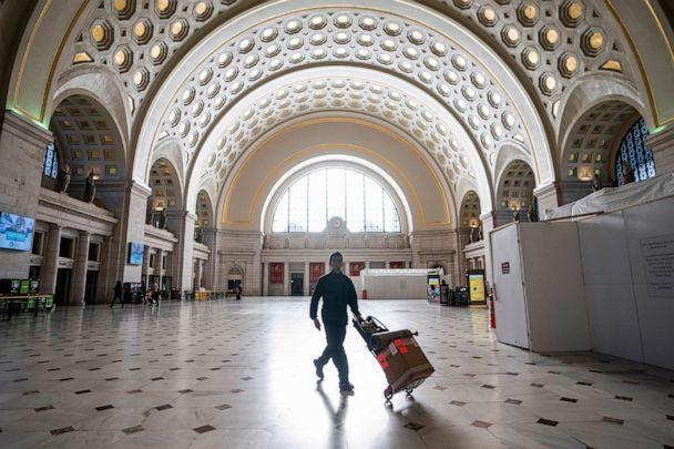 PHOTO: Washington Union Station, a major transportation hub in the nation's capital, is nearly empty during morning rush hour as many government and private sector workers stay home during the coronavirus outbreak, in Washington, D.C., March 16, 2020. (J. Scott Applewhite/AP)