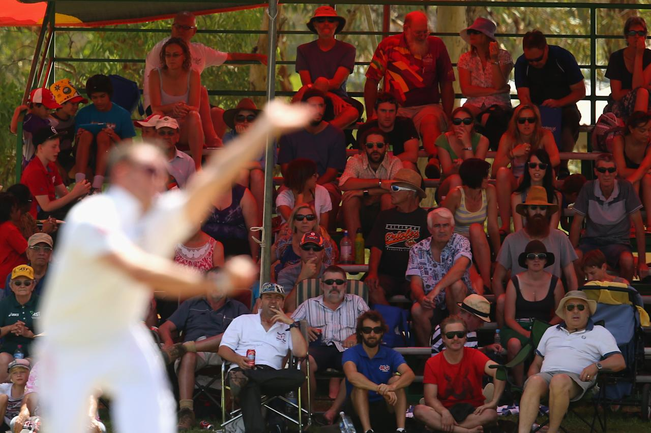 ALICE SPRINGS, AUSTRALIA - NOVEMBER 30: Spectators watch on during day two of the tour match between the Chairman's XI and England at Traeger Park Oval on November 30, 2013 in Alice Springs, Australia.  (Photo by Mark Kolbe/Getty Images)