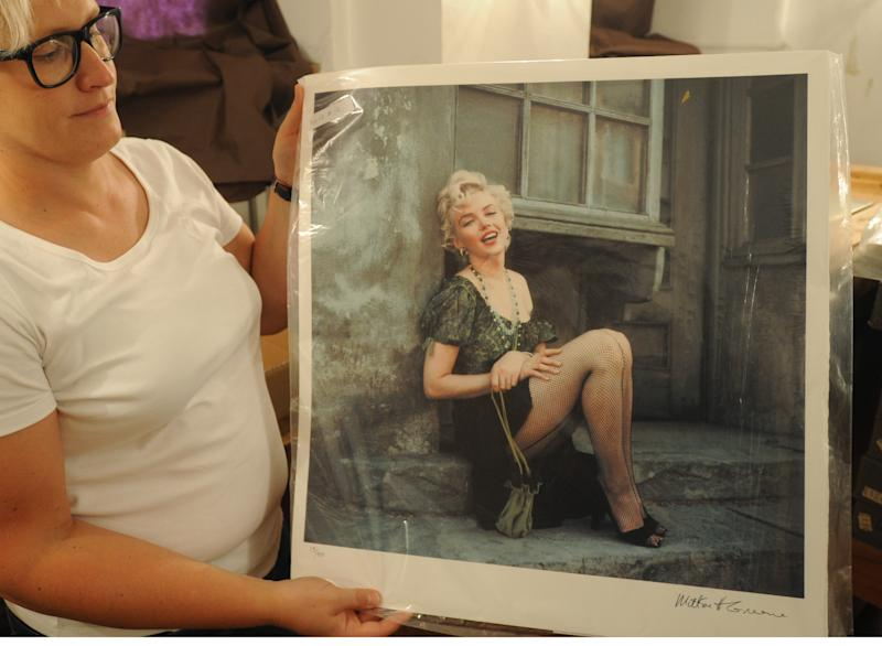 Photo gallery curator Anna Wolska presents a photo of Marylin Monroe by the late celebrity photographer Milton H. Greene, in Warsaw, Poland, Friday, July 20, 2012. Poland plans to auction off part of a photographic collection that includes hundreds of photographs of Marilyn Monroe which ended up in Poland's possession as the result of a complex embezzlement scandal that shook the country in the early 1990s. (AP Photo/Alik Keplicz)