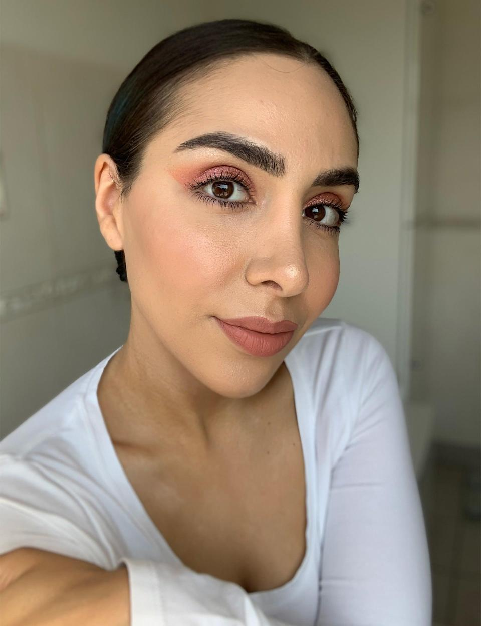 """Mario's <a href=""""https://www.cultbeauty.co.uk/makeup-by-mario-master-metallics-eyeshadow-palette.html"""" rel=""""nofollow noopener"""" target=""""_blank"""" data-ylk=""""slk:Master Metallics Eyeshadow Palette, £41"""" class=""""link rapid-noclick-resp"""">Master Metallics Eyeshadow Palette, £41</a>, is a beautiful collection of jewel tones and gold hues. With mattes reigning supreme, metallics feel somewhat outdated to me but the pictures on Mario's <a href=""""https://www.instagram.com/p/CMNm76slvgt/"""" rel=""""nofollow noopener"""" target=""""_blank"""" data-ylk=""""slk:Instagram"""" class=""""link rapid-noclick-resp"""">Instagram</a> persuaded me to give it a go. Again, brushes don't pick up the pigment (unless wet) so Mario suggests using your finger instead. This worked a treat and I blanketed my lids in the pretty pink colour. I expected something very lurid at first swipe but it lent my lids an understated sheen and the eyeshadow can be layered up for a deeper colour. Just like the metal palette, there was no dusty fallout so I didn't have to tidy up or redo my foundation. Personally, this isn't a palette I'd use every day but for festivals and nights out, it's perfect. <br><br>The blush and lipstick I'm wearing here aren't Makeup by Mario, nor are they available at Cult Beauty just yet, but you can shop many more MbM products direct from his website: <a href=""""https://www.makeupbymario.com/"""" rel=""""nofollow noopener"""" target=""""_blank"""" data-ylk=""""slk:www.makeupbymario.com"""" class=""""link rapid-noclick-resp"""">www.makeupbymario.com</a>.<br><br><strong>Makeup By Mario</strong> Master Metallics Eyeshadow Palette, $, available at <a href=""""https://www.cultbeauty.co.uk/makeup-by-mario-master-metallics-eyeshadow-palette.html"""" rel=""""nofollow noopener"""" target=""""_blank"""" data-ylk=""""slk:Cult Beauty"""" class=""""link rapid-noclick-resp"""">Cult Beauty</a>"""