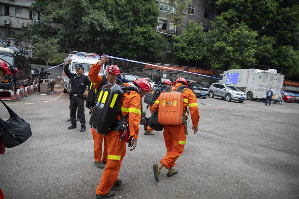 In this photo provided by China's Xinhua News Agency, rescuers arrive at a coal mine in southwest China's Chongqing Municipality, Sunday, Sept. 27, 2020. More than a dozen of people died Sunday in the coal mine in southwestern China because of excessively high levels of carbon monoxide, authorities and state media said. (Huang Wei/Xinhua via AP)