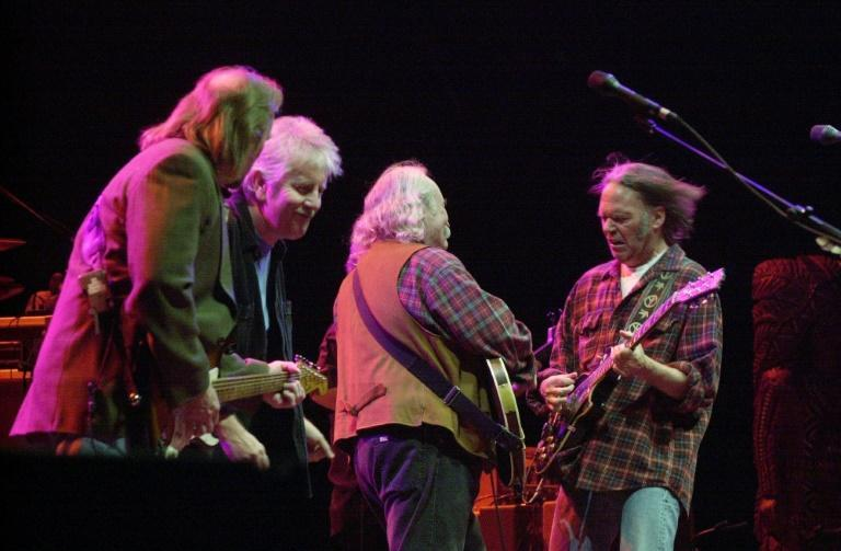 Stephen Stills (L), Graham Nash (2nd L), David Crosby (2nd R) and Neil Young (R) perform live in 2000