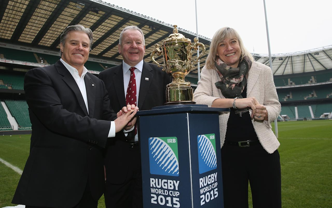 LONDON, ENGLAND - NOVEMBER 27: (L-R) Brett Gosper, the IRB chief executive, Bill Beaumont, the RFU Chairman and Debbie Jevans, chief executive of England Rugby 2015 pose with the Webb Ellis Cup during the England 2015 Rugby World Cup Ticketing and Times launch on November 27, 2013 in London, England. (Photo by David Rogers/Getty Images)