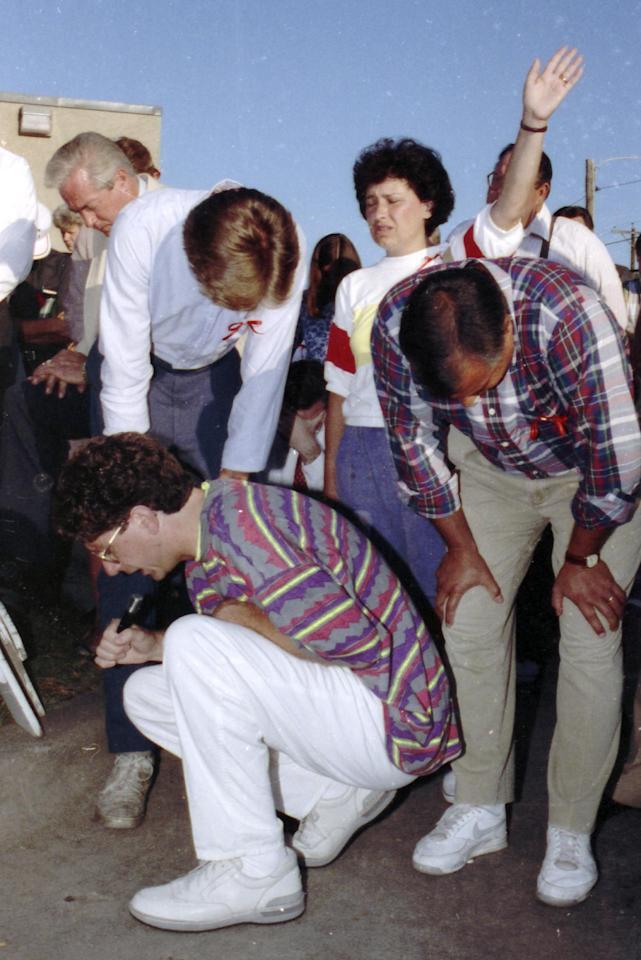 FILE - In this Tuesday, Aug. 6, 1991 file photo, Operation Rescue founder Randall Terry kneels in prayer outside the Woman's Health Care Services abortion clinic in Wichita, Kan. with over 1,000 other protesters. Protests are planned again this summer at the clinic to mark the 25th anniversary of the 1991 Summer of Mercy protests that led to nearly 2,700 arrests. (AP Photo/Steve Rasmussen)